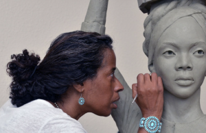 Artist Vinnie Bagwell works on one of her Enslaved Africans' Rain Garden sculptures